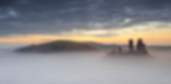 Corfe Castle Rising Through The Mist