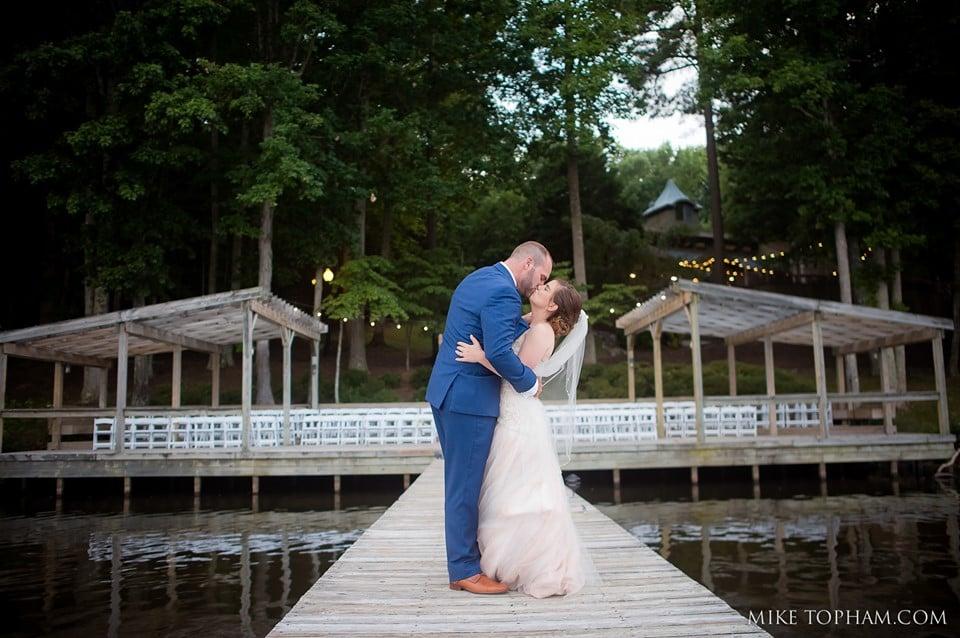 bride + groom kissing at landing