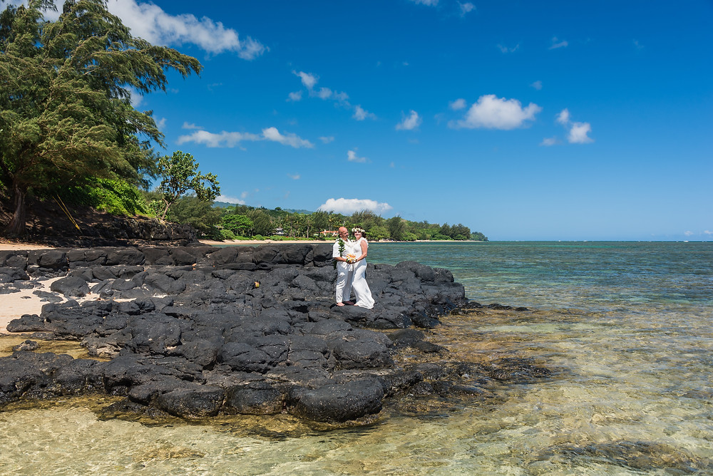 bride and groom at anini beach on kauai