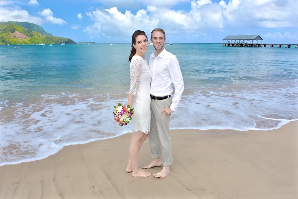 Bride and groom on the beach in Kauai