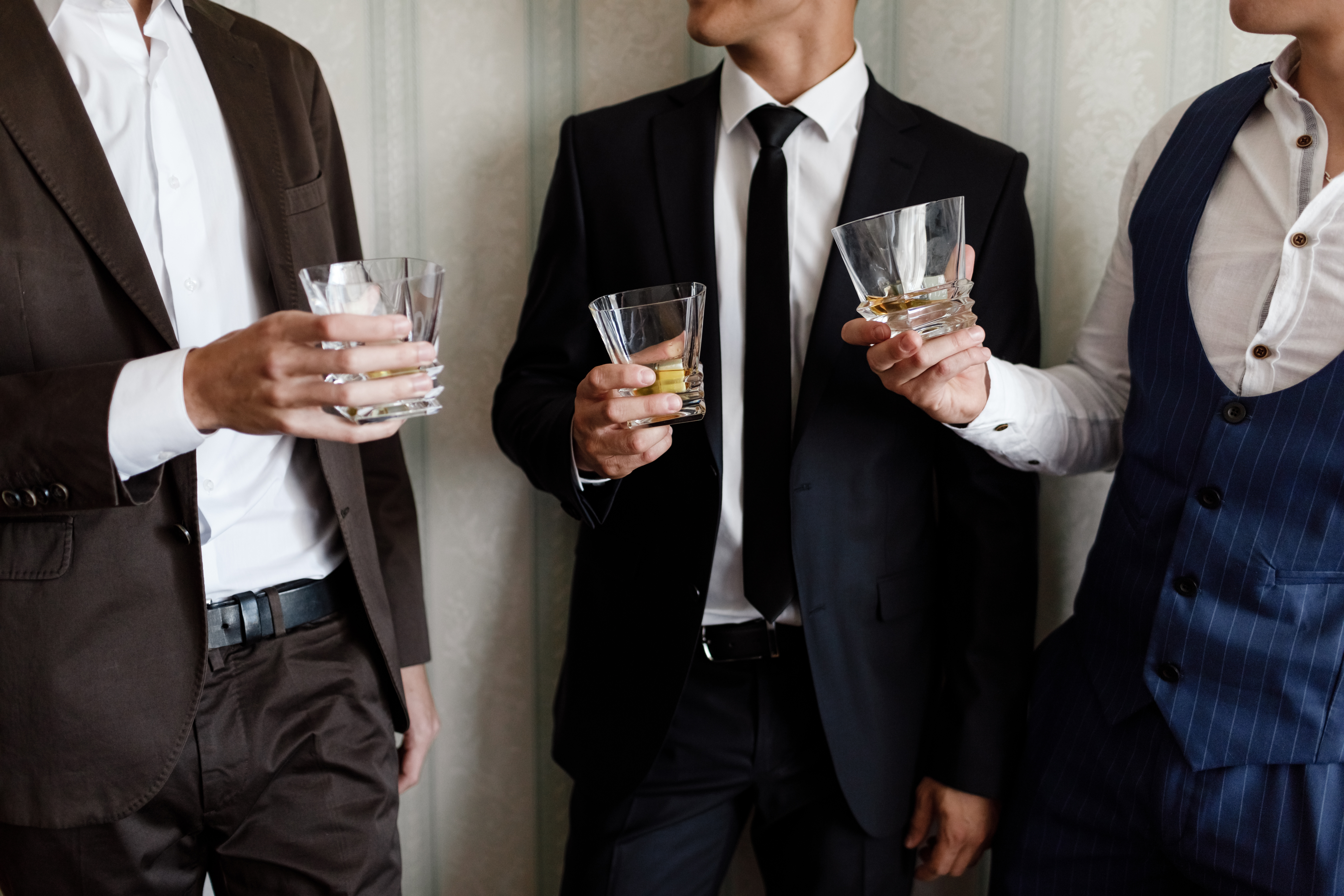 stylish friends businessmen in suits toa