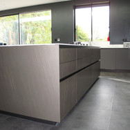 Italian handless kitchen. The Comprex island doors, drawer fronts and panels are in a 12mm brushed aluminium