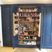 Pantry with oak storage racks
