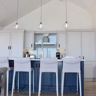 Bespoke hand painted in-frame kitchen.  Farrow & Ball paint colours: kitchen in Cornforth White, island in Stiffkey Blue