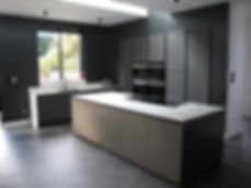 Italian true handleless kitchen.  Arredo3 glass doors and Comprex brushed aluminium island