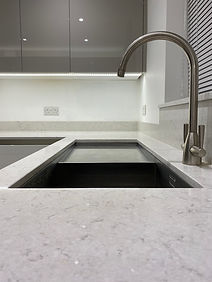 Caple undermount sink with drainer set in 20mm quartz worktop.  Franke Eiger tap.