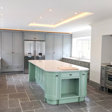 Bespoke hand-painted in-frame kitchen with quartz worktop. Kitchen colour Farrow & Ball Manor House Gray, island Dulux Dewy Lawn