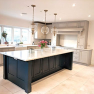 Bespoke hand painted in-frame kitchen.  Farrow & Ball colours: kitchen in Cornforth White, island in Inchyra Blue