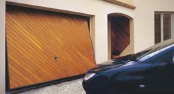 Porte basculante débordante