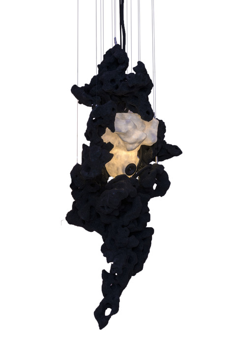 Spores, 2018  5 rock sculptures, one of which is translucent, suspended by means of steel cables, held in place by stainless steel fixings.   Resin rocks, matte Architecte OR NOIR paint, inclusion resin and matte fiberglass mat, sound and light system inside the translucent rock   specially made control box with 1 USB port, 2 rotary potentiometers (volume adjustment and light bulb flashing sensitivity), 3 loud-speakers (60 W, 84,6 dB), 240 V, 2,8 W LED bulb with filament (21 W perceived), MP3 reader.  Dimensions: height : 2,8 m, width: 98,5 cm, depth: 65,2 cm.