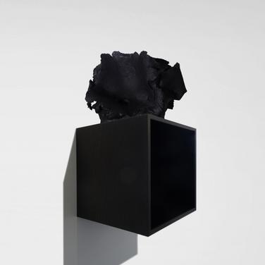 Study for a Solipsism, 2018  Iraqi chamotte ceramics, blown up by a C-4 type plastic explosive, matte black lacquer paint. Oak boxes dyed black, black mirrors.   Box dimensions: 34,5cm x 34,5 cm, depth: 34cm – Dimensions of each stoneware piece: 34,5 cm, width: 25 cm, depth: 30 cm.