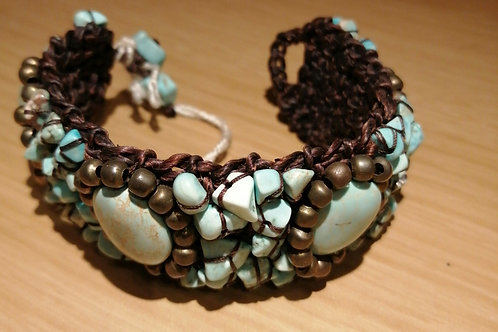 Adjustable cuff with blue and brown stones