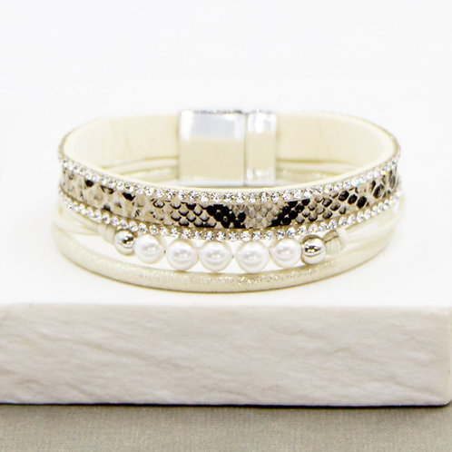 Cream bracelet with magnetic clasp and snakeskin and pearl feature