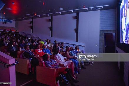 Audience members watch the screening of 'BET Twenties'
