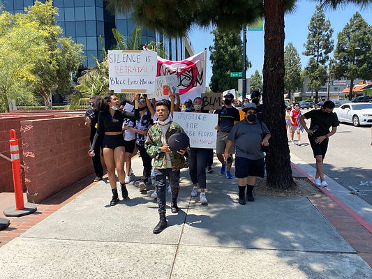 Protest organizers Natalie Kinlow (left) and Reed Shannon (right) leading the protest in Burbank, CA.