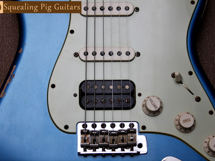 """Is it true that """"guitar finish thickness"""" affects its natural tone?"""