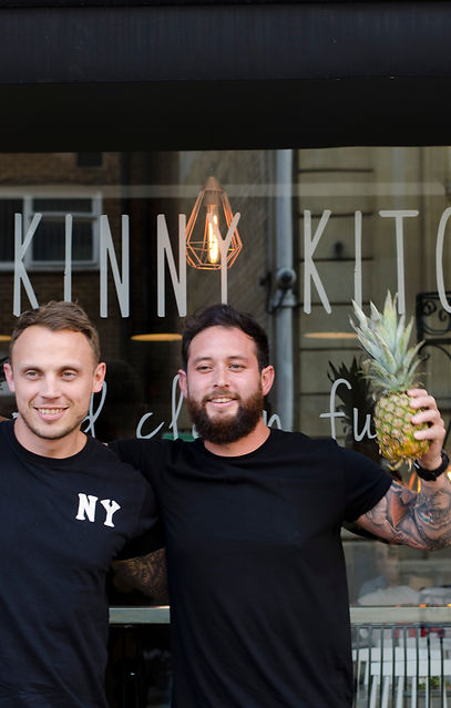 Two men holding pineapple healthy restaruant gym protein