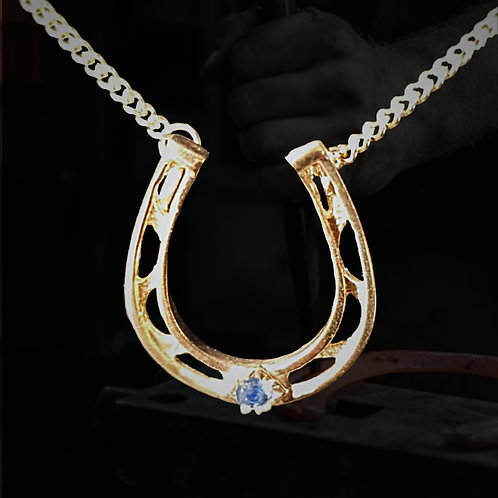 Gold Horseshoe with Sapphire
