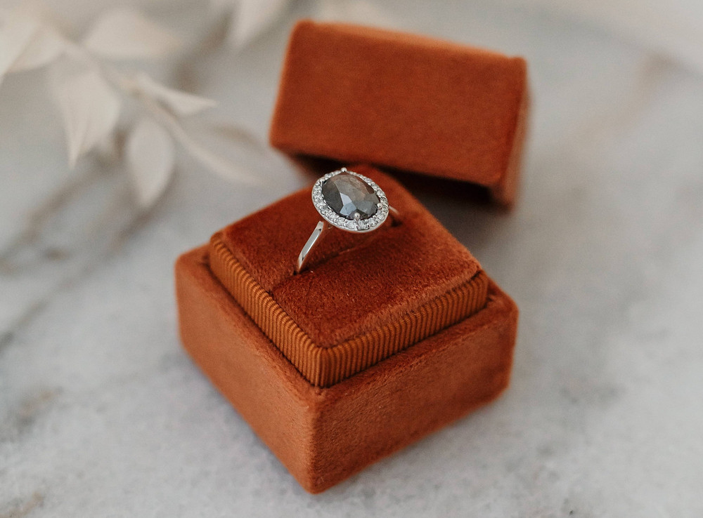 Salt and pepper ring with diamonds on the setting
