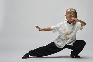 Woman crouched into a defensive Qi Gong posture