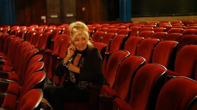 Penny on the phone in Leciester Square Theatre the morning of the final show.
