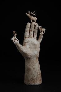 Hand with Deer_300dpi.jpeg