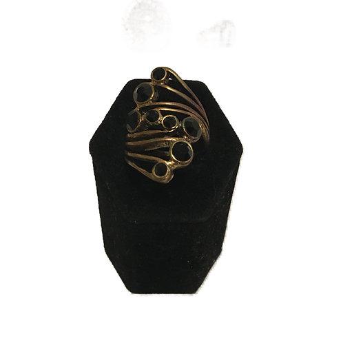 Unusual Gilt Metal and Black Multi-stone Ring