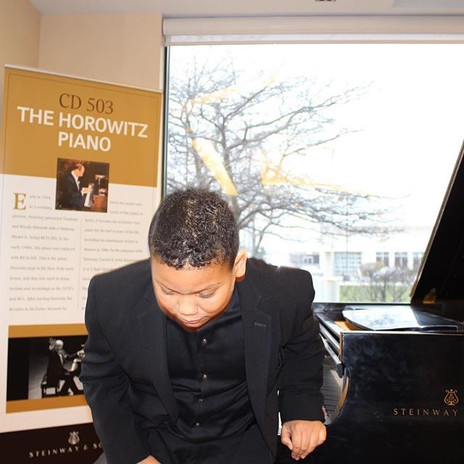 Joshua bowing after performing on The Horowitz Piano
