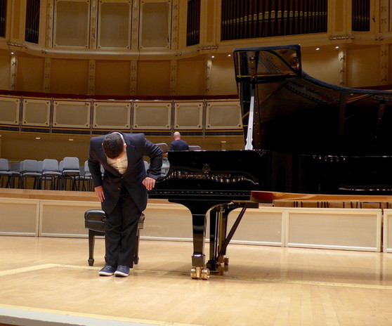 Joshua bowing after a performance at Chicago Symphony Hall