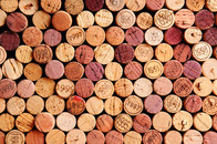 Closeup of a wall of used wine corks. A random selection of used wine corks, some with vintage years.jpg