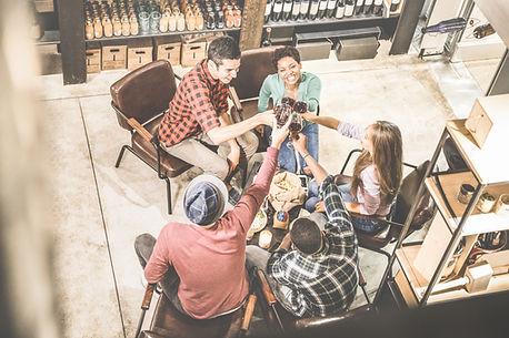 Top view of multi racial friends tasting