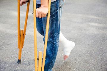 Teen on crutches