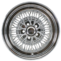 "Truespoke wire wheel, standard type with a round ""Donut"" hubcap"
