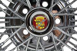 "Brougham 50 Cadillac round ""Donut"" hubcap"