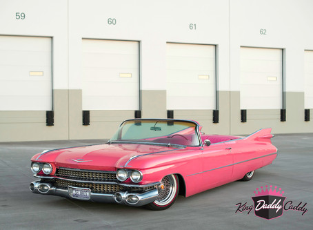 A Pink Cadillac with Red Stripe Vogue Tires