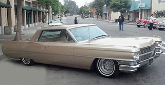 Cadillac Coupe DeVille with reverse style Brougham 50 wire wheels by Truespoke