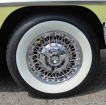 Chrome wire wheel with wide whitewall tire