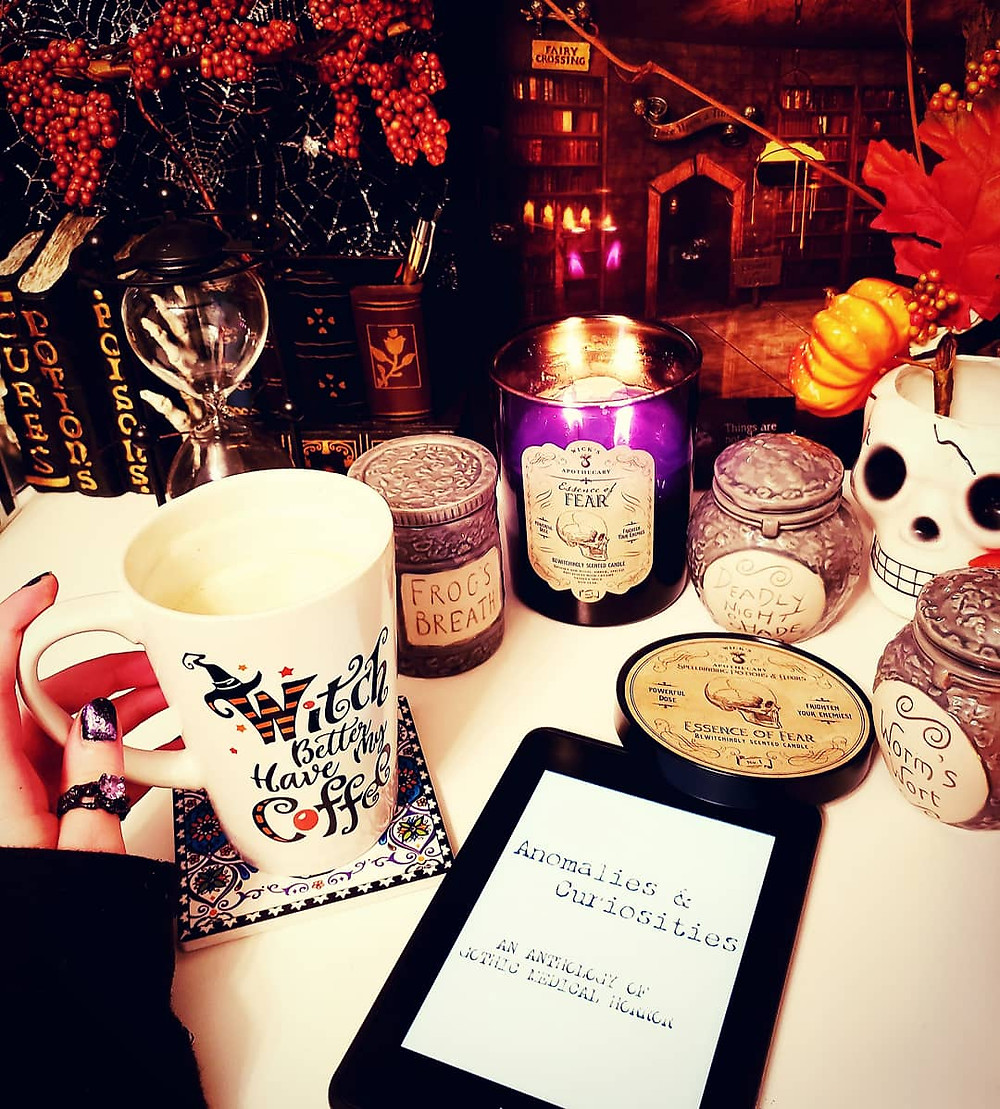 Anomalies and Curiosities Book Review Coffee, Book, and Candle
