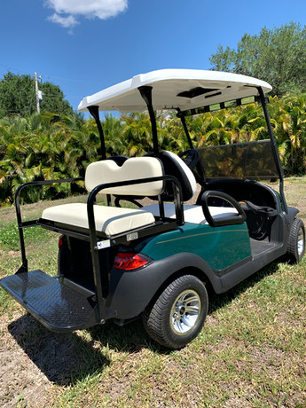All carts start as 2 seaters with golf cart bag holders.  Bag holders can be left on for golfing!