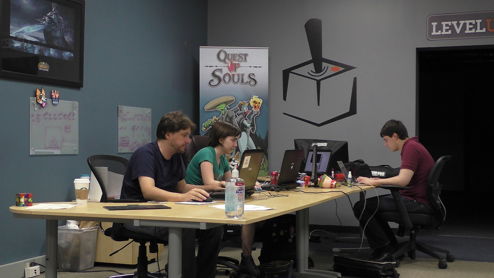 Josh, Sam, and Ken working in the office