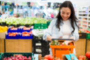 smiling-asian-woman-sorting-goods-market