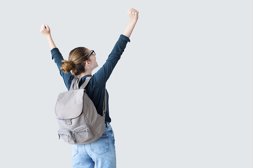 Happy student with arms raised on air.jp