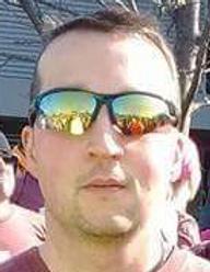 Coach Jeremy Moll.png