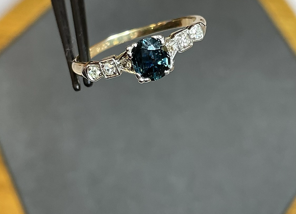 14k ring with .60 ct teal sapphire, .12 ctw diamonds