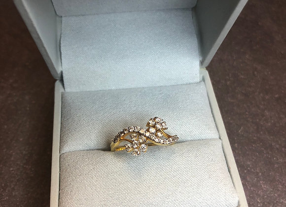 14k gold floral ring .30 ctw, size 7