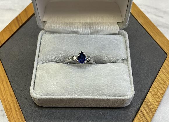 Platinum ring with sapphire and diamonds