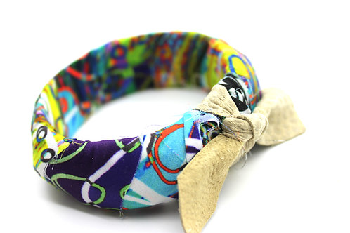 Fabric wrapped bangle in Takin' Care of Business print