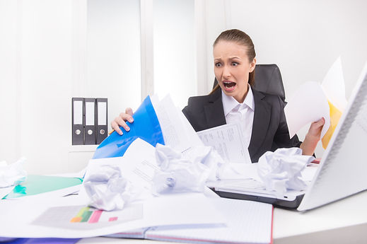 Mess on the working place. Shocked woman