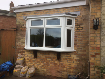 A conversion of a flat window to a bay window with a leaded roof