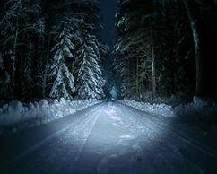 snowy road with headlights (2).jpg